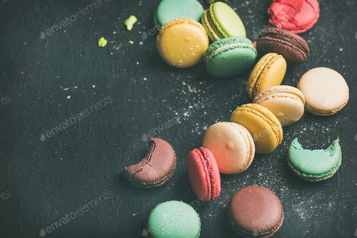 Sweet colorful French macaroon cookies variety with sugar powder