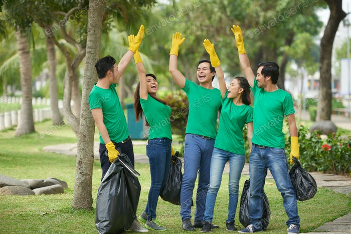 Cheerful young people collected garbage