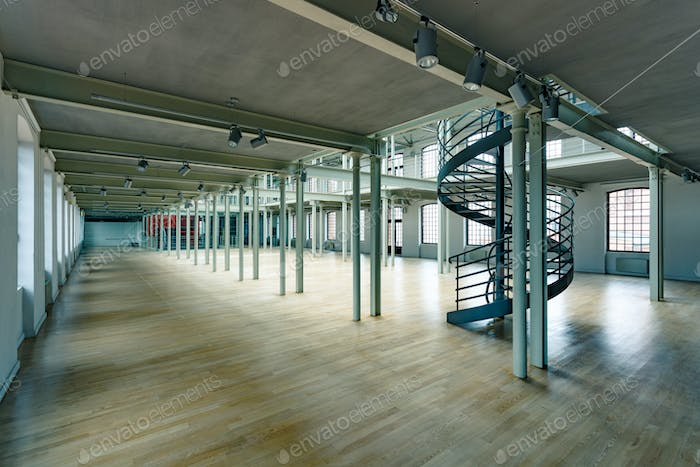 Industrial interior with round stairs