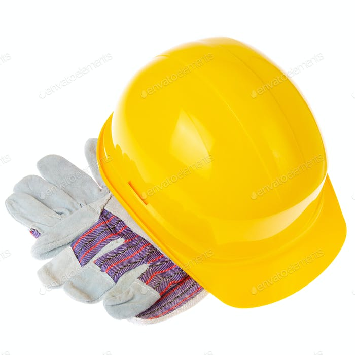 Yellow plastic hard hat and protective gloves isolated on white background. Safe labor concept