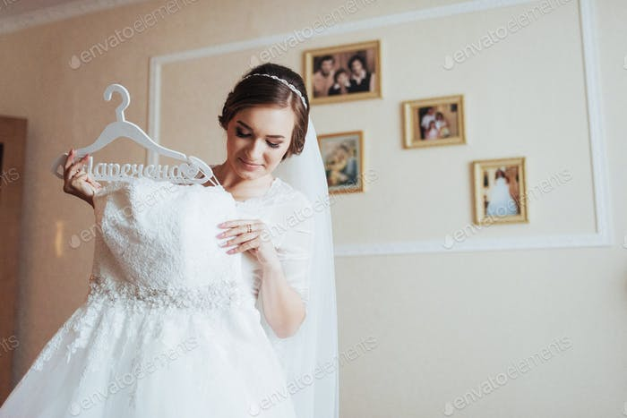 girl trying on wedding dress