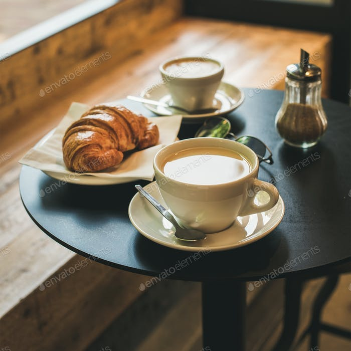 Coffee latte, cappuccino and croissant on table , square crop