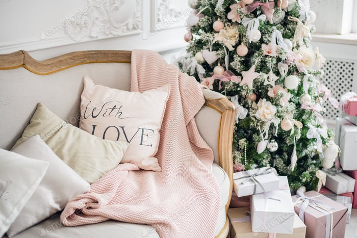 christmas coziness christmas tree, pillows on a couch feather pink veil blanket of thick yarn