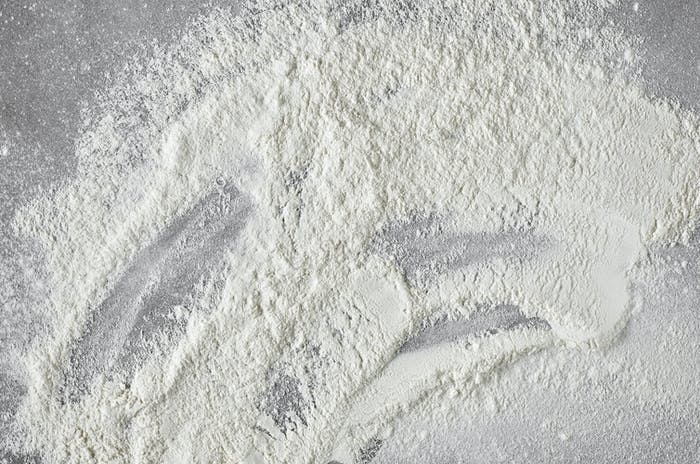 white flour on grey kitchen table