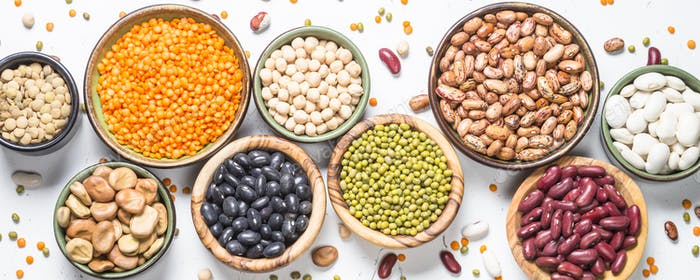 Legumes, lentils, chikpea and beans assortment on white.