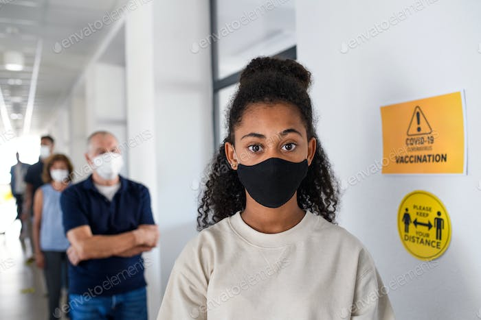 Portrait of girl with face mask, coronavirus, covid-19 and vaccination concept