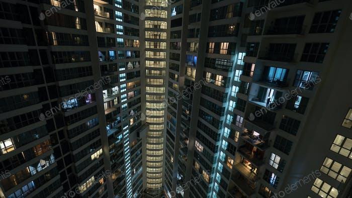 Window lights in multistorey house at night, Kuala Lumpur