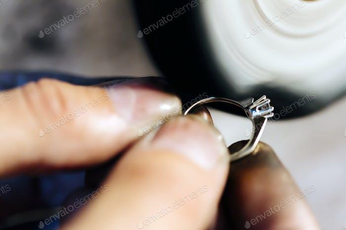 Jeweler polishing jewelry