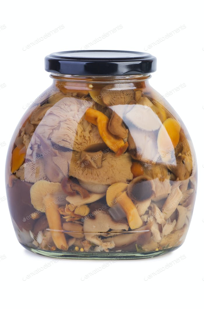 Glass jar with assorted marinated mushrooms
