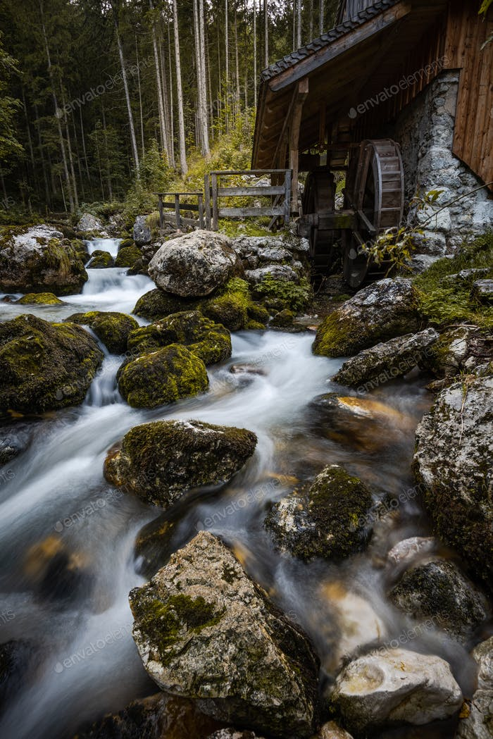 Creek Flowing by Ancient Wooden Mill near Gollinger Waterfall