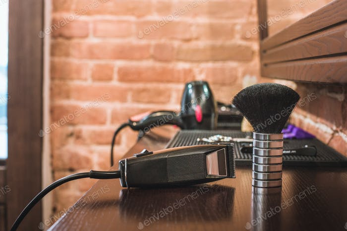 Barber shop equipment on wooden background.