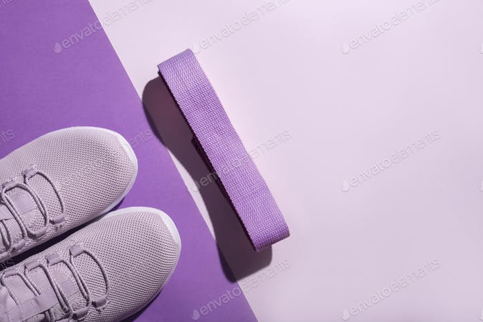 New purple sneakers and strap on colorful background