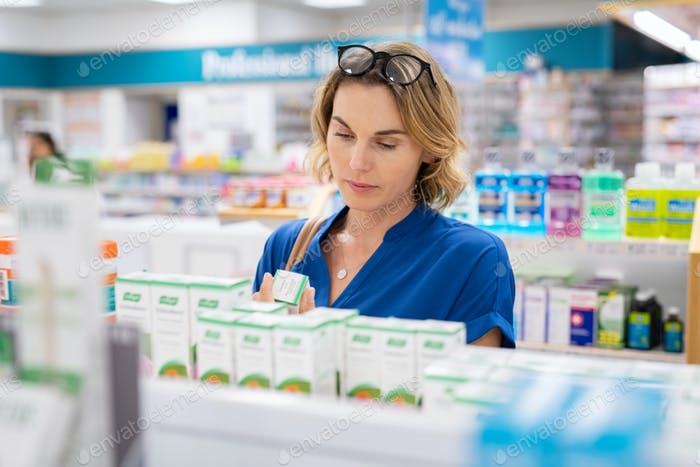 Woman choosing product in pharmacy