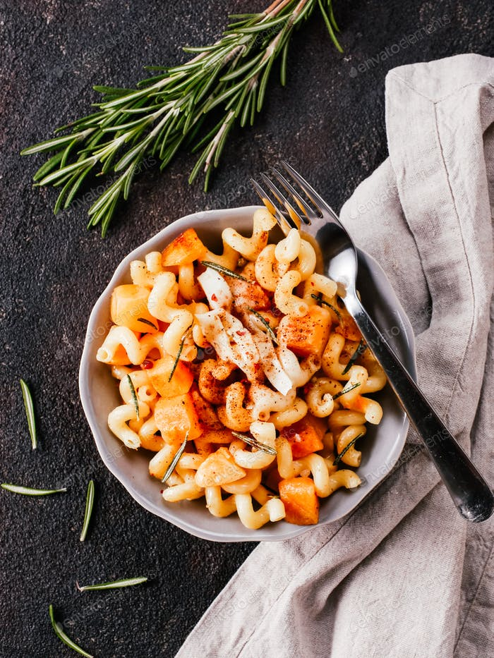Fusilli pasta with pumpkin, rosemary and brie