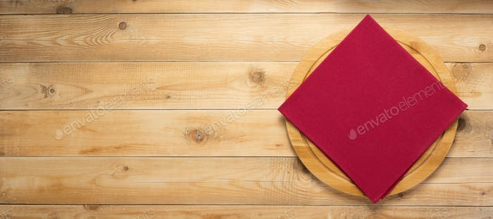 pizza cutting board and naplin at wooden background