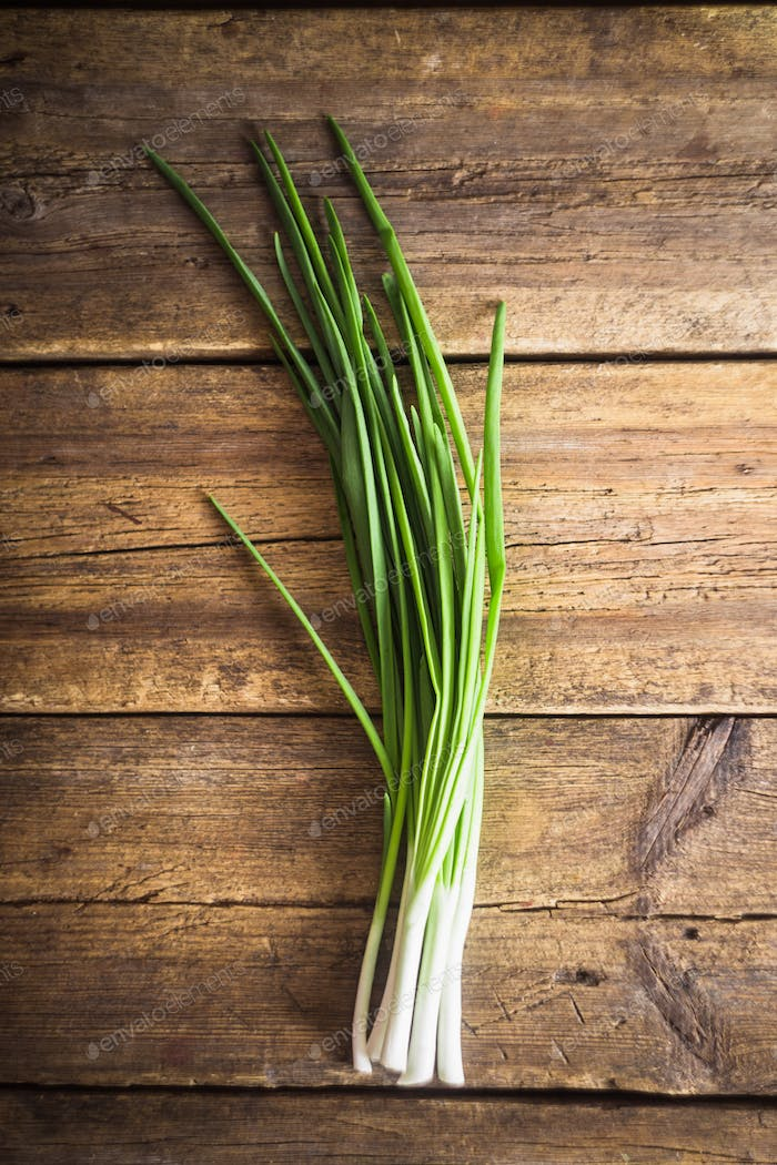 Green onions on wooden background. Cooking