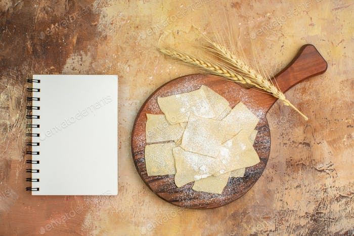 top view raw dough slices with flour on wooden desk pasta dish cuisine