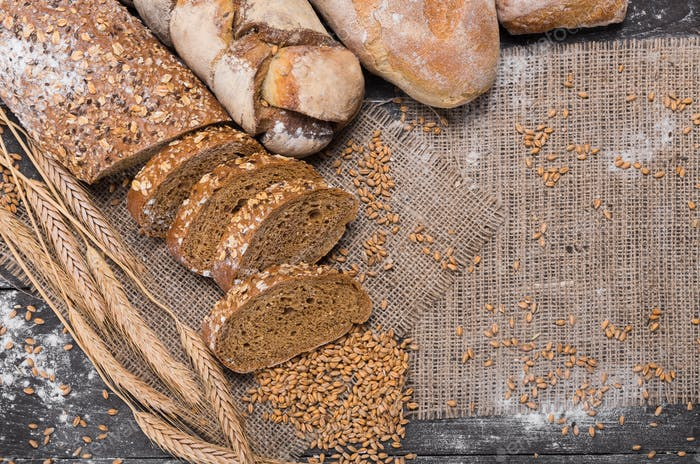 Bakery concept. Sliced rye bread background with copy space