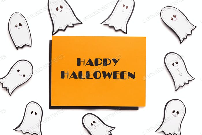 Happy halloween text on orange background with ghosts