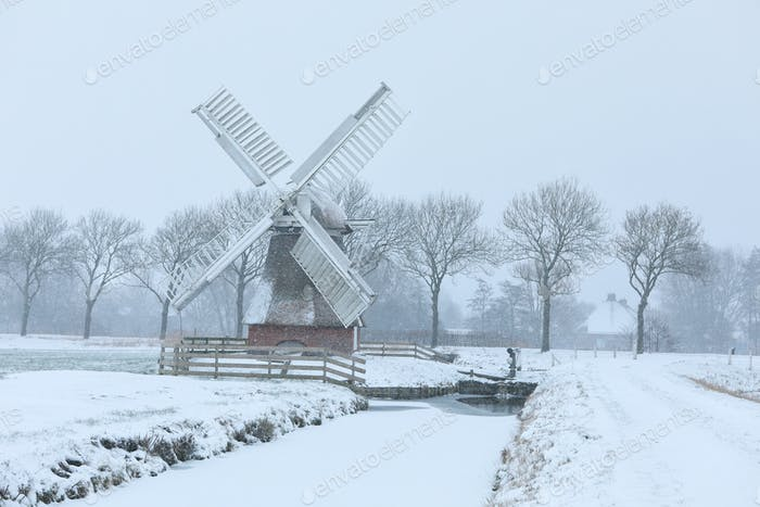 Dutch windmill in snowstorm