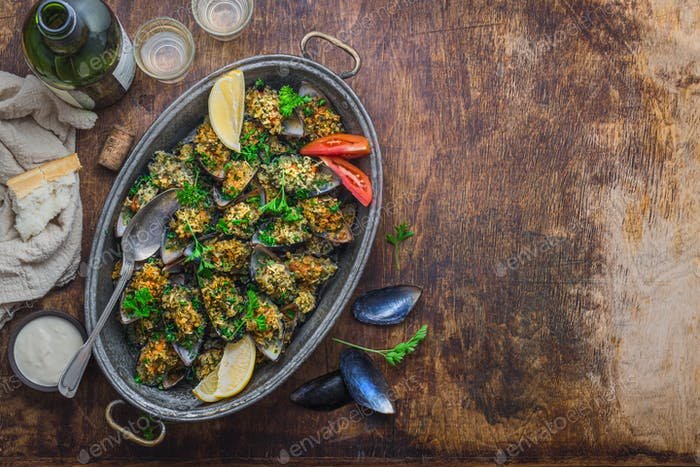 Baked mussels with cheese parmesan and bread crumbs, copy space