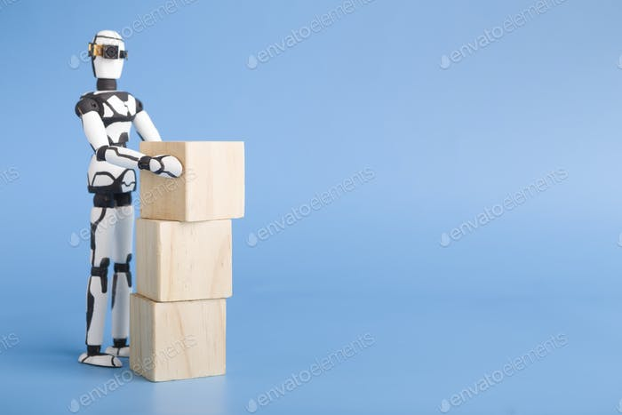 Robot sorting boxes, blue studio background with empty space