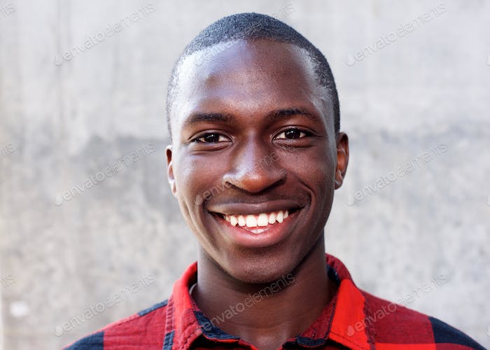 Smiling face of young african man