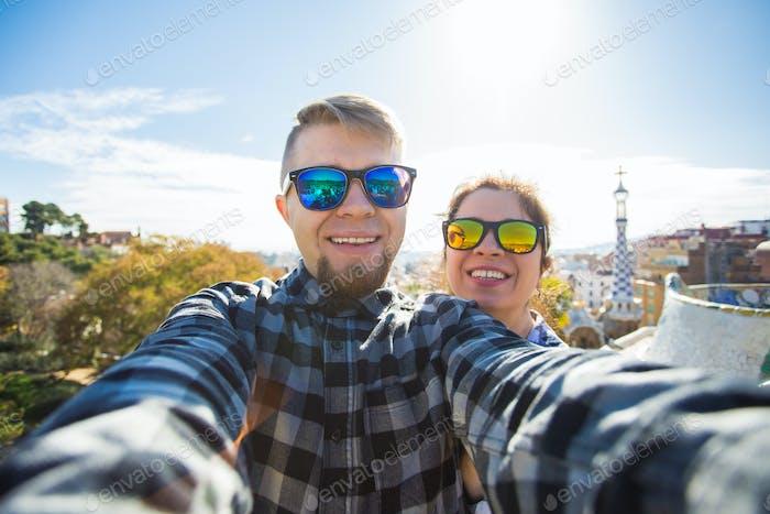 Couple Make Selfie Portrait  In Park Guell, Barcelona, Spain