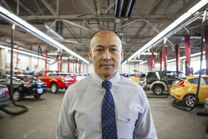 Portrait of Pacific Islander owner of a car repair shop