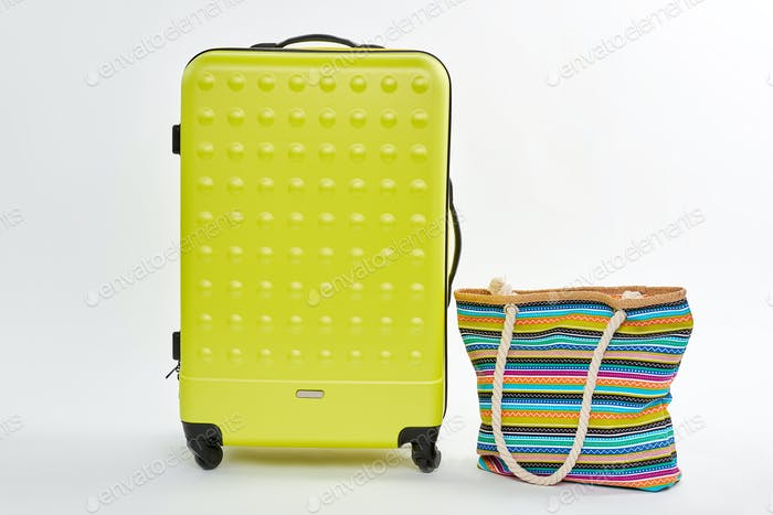 Bright summer suitcase on wheels