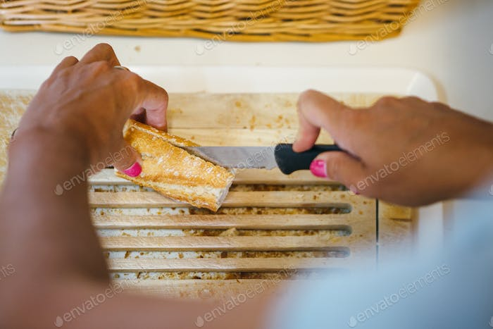 Person cutting loaf