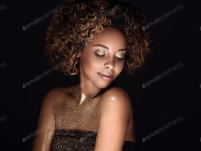 Gold skin -  African american woman  - beauty hairstyle beautiful makeup concept