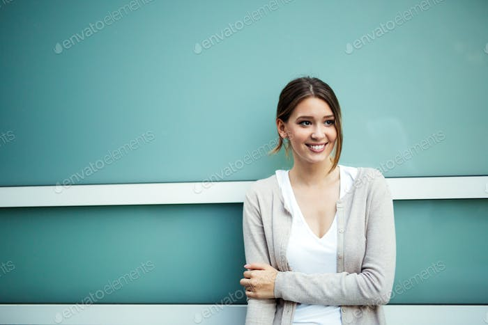 Portrait of beautiful young happy woman smiling