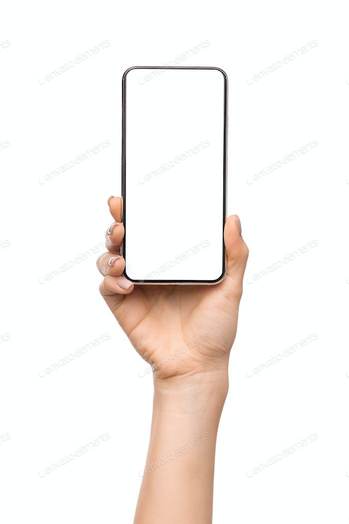 Female hand presenting new smartphone with big blank screen