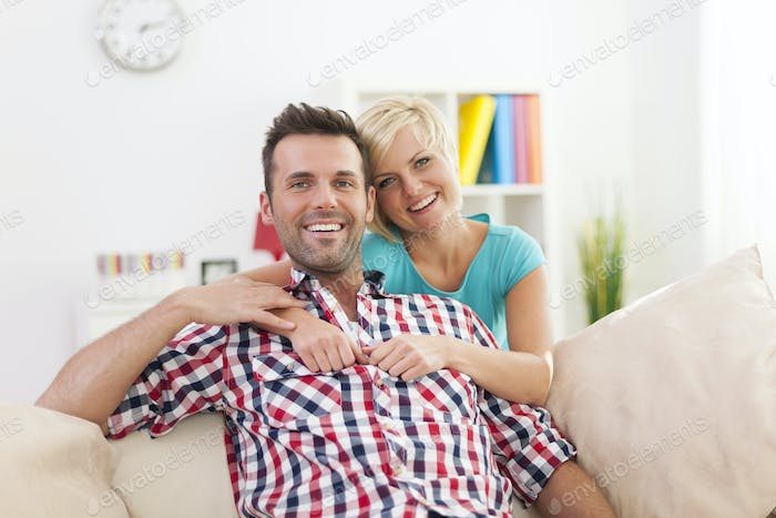 Portrait of beautiful smiling couple at home