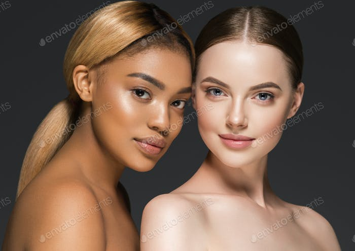 Different ethnic american african and caucasian woman beauty face portrait