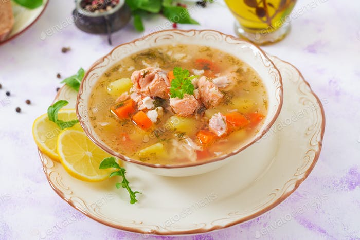 Salmon soup with vegetables in bowl