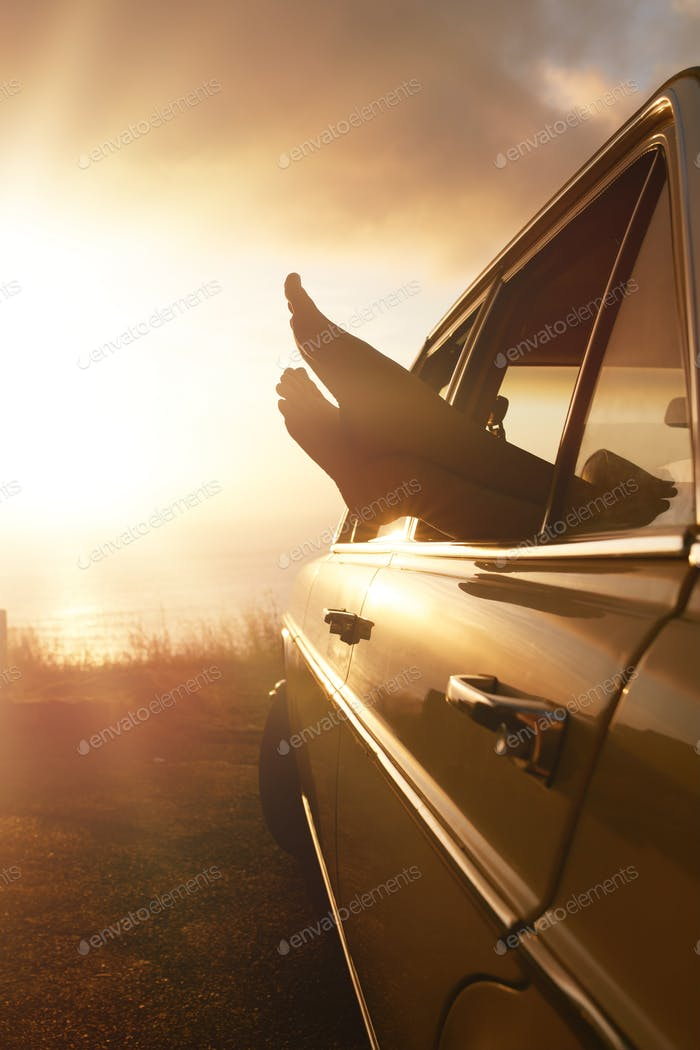 Woman feet out of car window