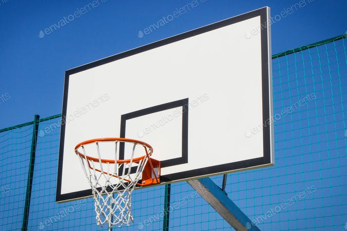 Basketball board with basket hoop on playground