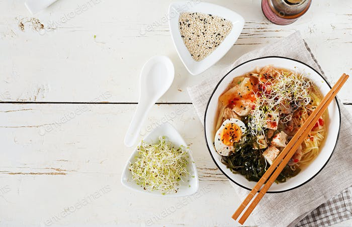 Miso Ramen Asian noodles with cabbage kimchi, seaweed, egg, mushrooms and cheese tofu