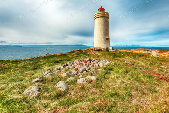 Stunning view of Skarsviti lighthouse in Vatnsnes peninsula on a clear day in North Iceland.