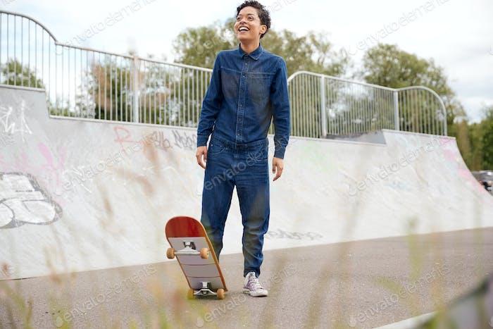 Two Female Friends Riding On Skateboards In Urban Skate Park