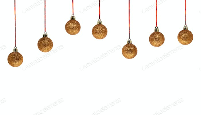 Row of golden christmas balls isolated on white background