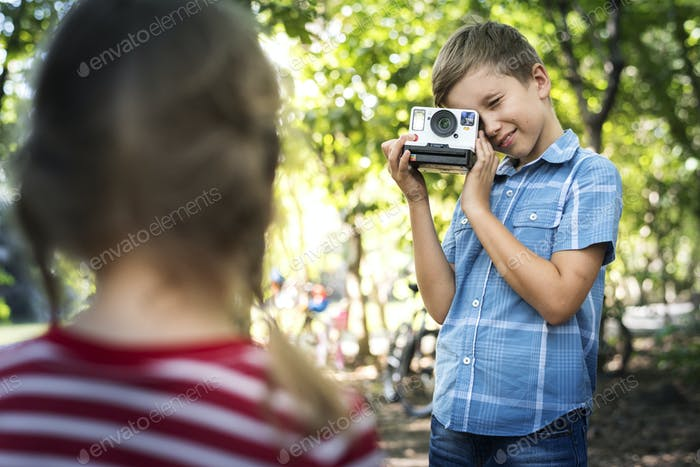 Boy using a vintage camera