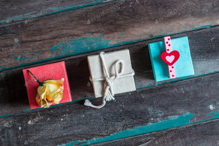 Multi-colored gift boxes on wooden