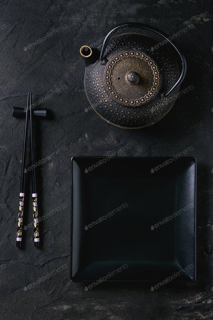 Asian tableware over black