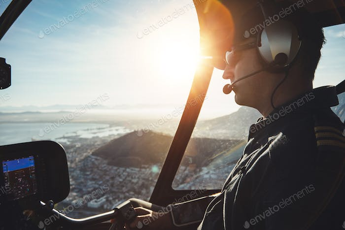 Pilot flying a helicopter