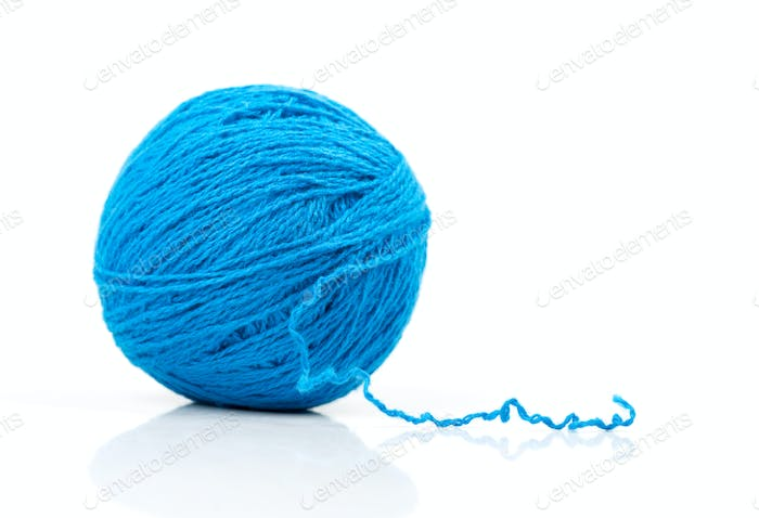 Blue ball of yarn on white