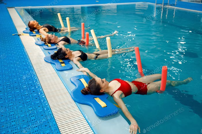 Female swimmers, aqua aerobics at the poolside