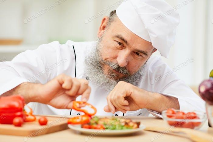 Chef Plating Dish in Restaurant